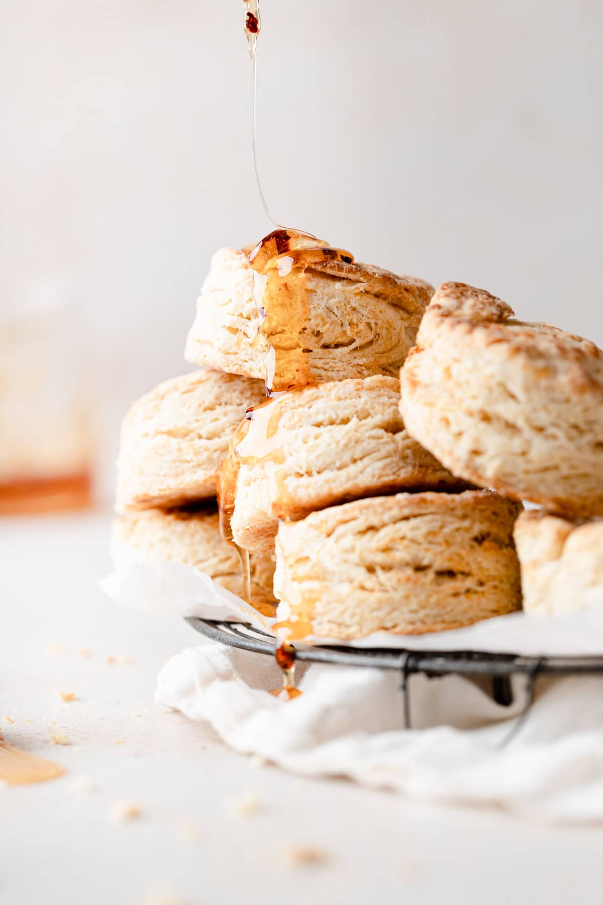 a drizzle of honey running down a pile of biscuits