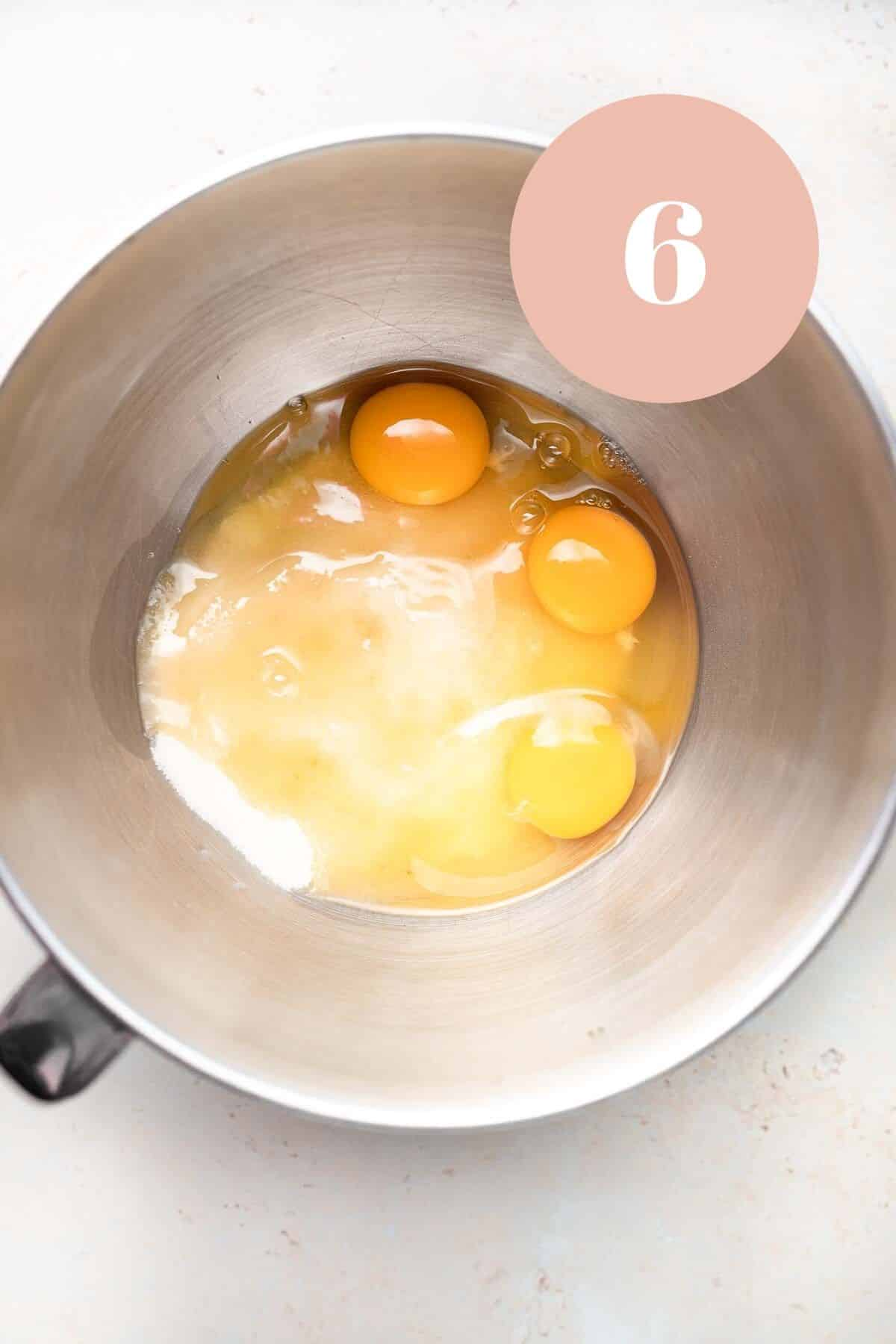 the eggs and sugar in a bowl for the ultimate brownie recipe.