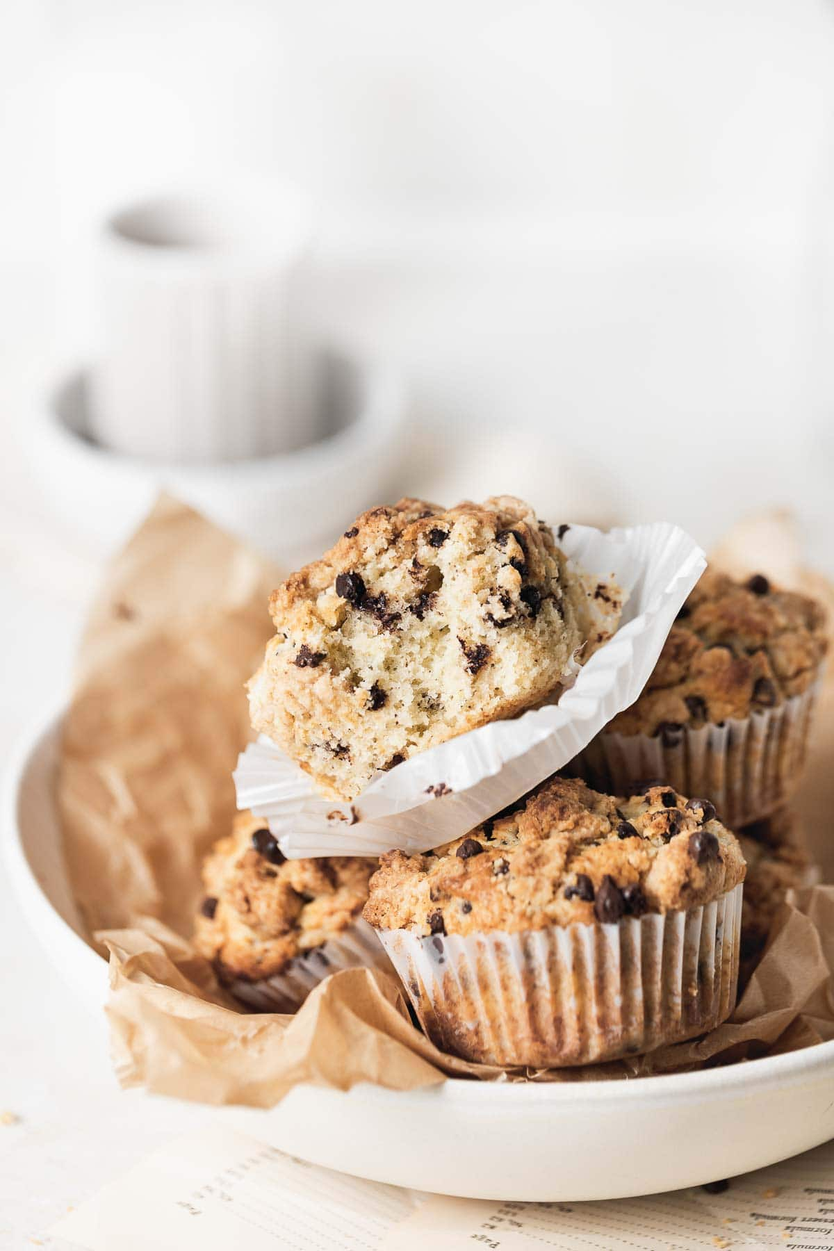 a stack of muffins in a white dish