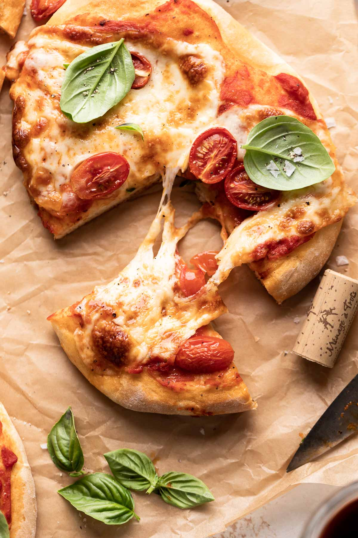 chewy pizza dough slice being pulled from the pizza.