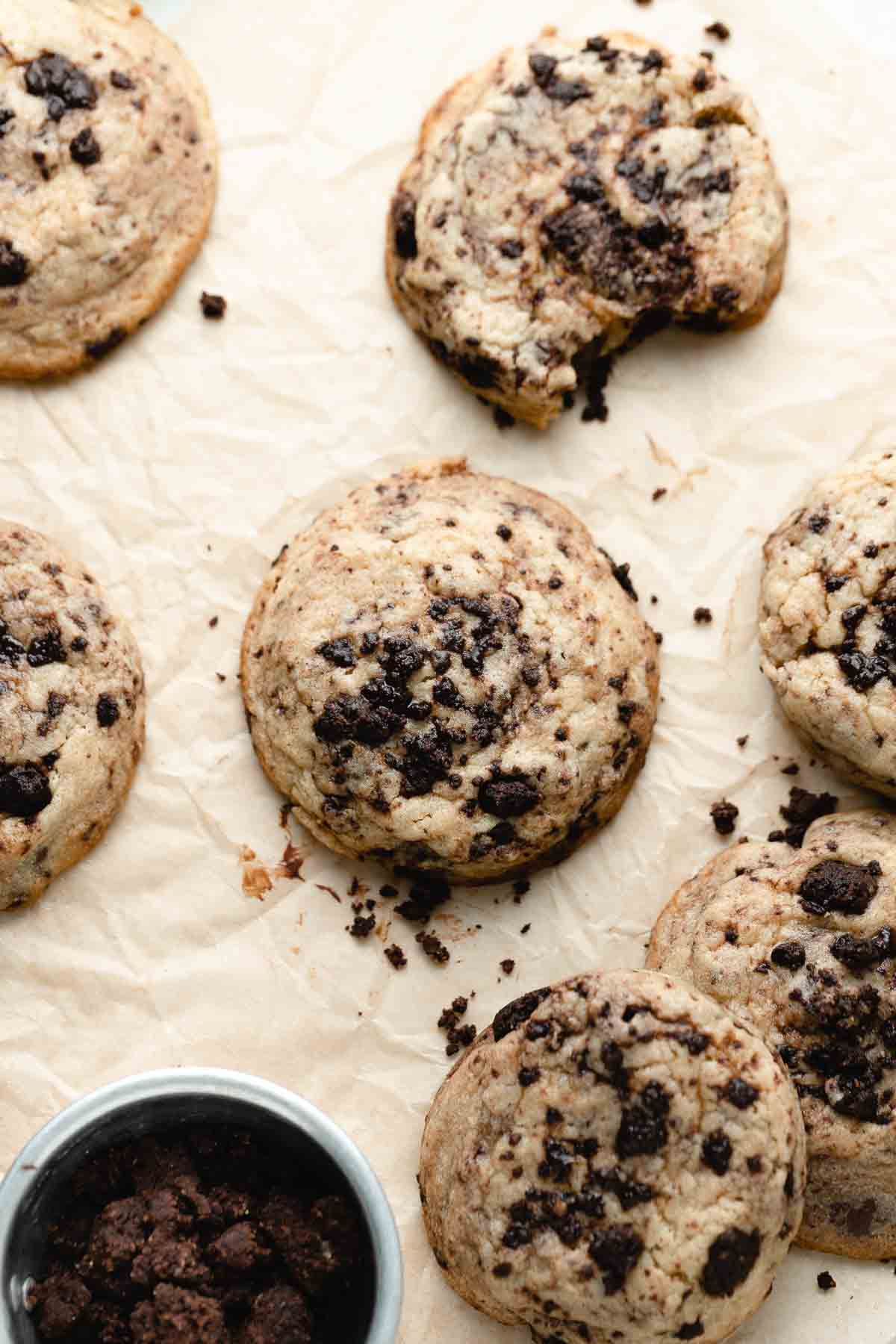 a few cookies on a piece of brown parchment paper