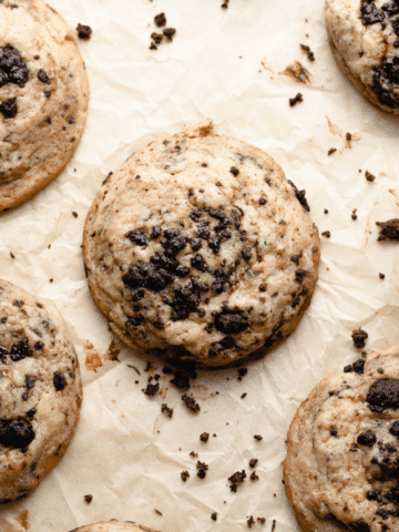 some of the cookies on a piece of brown parchment paper