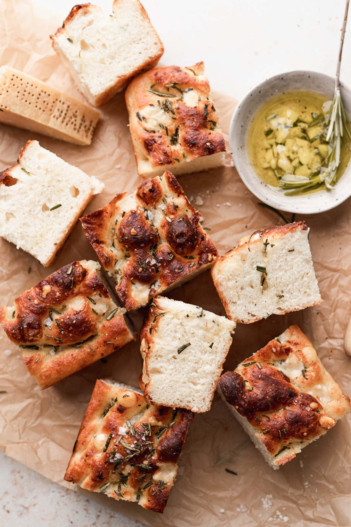 the sliced focaccia sitting on a brown piece of parchment paper