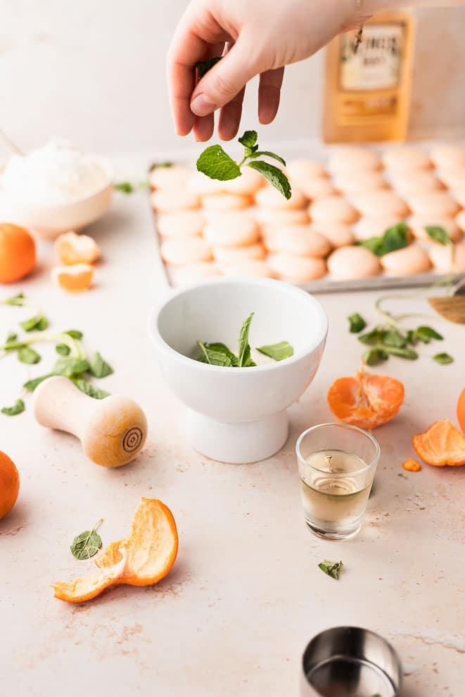 adding mint to a mortar and pestle