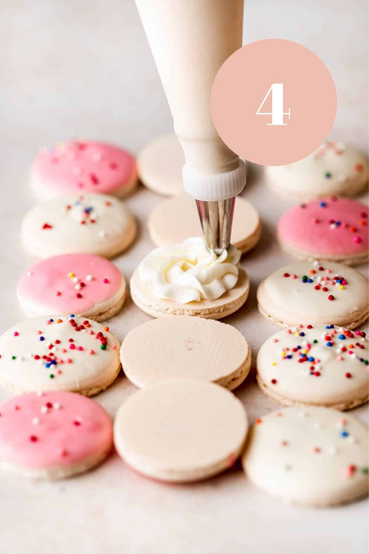 piping the cake batter buttercream on the birthday cake macarons.