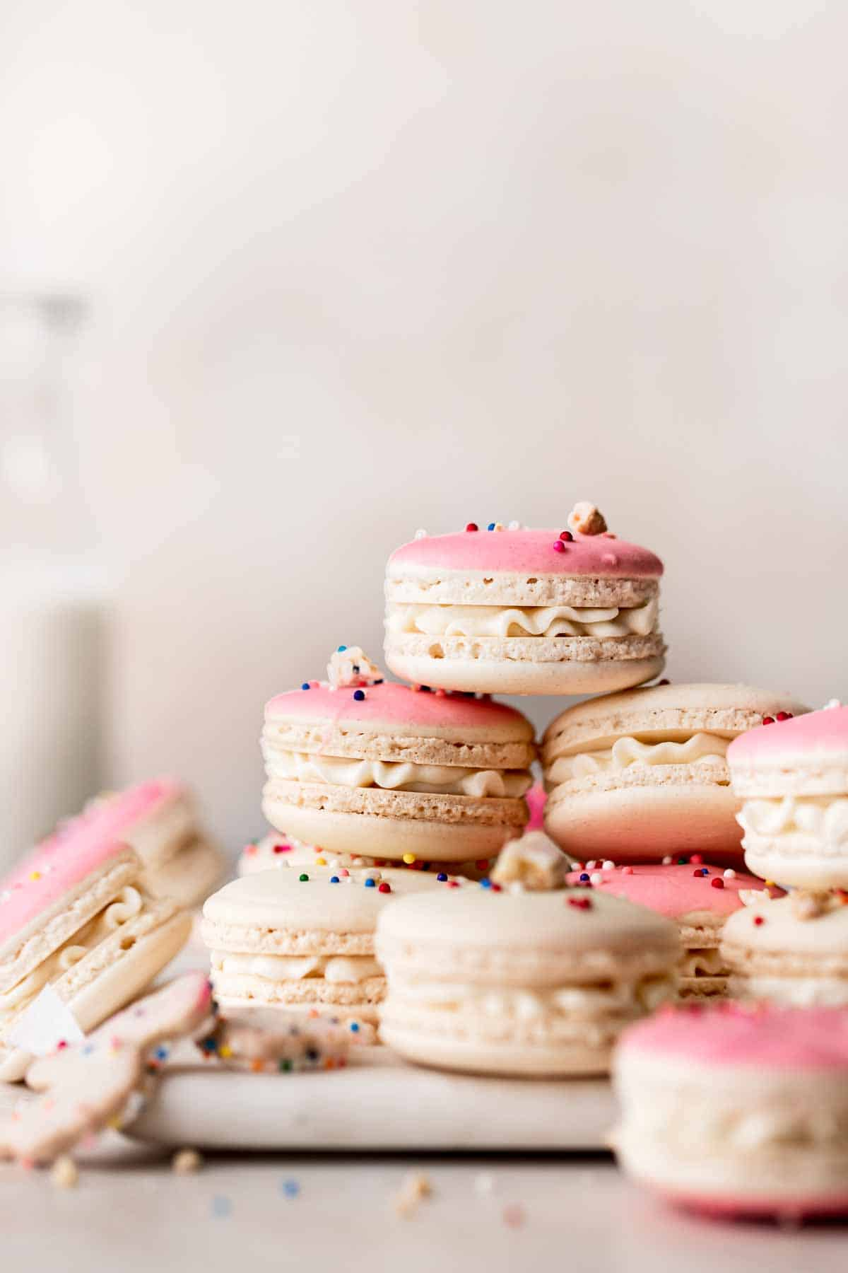 birthday cake macarons stacked on each other.