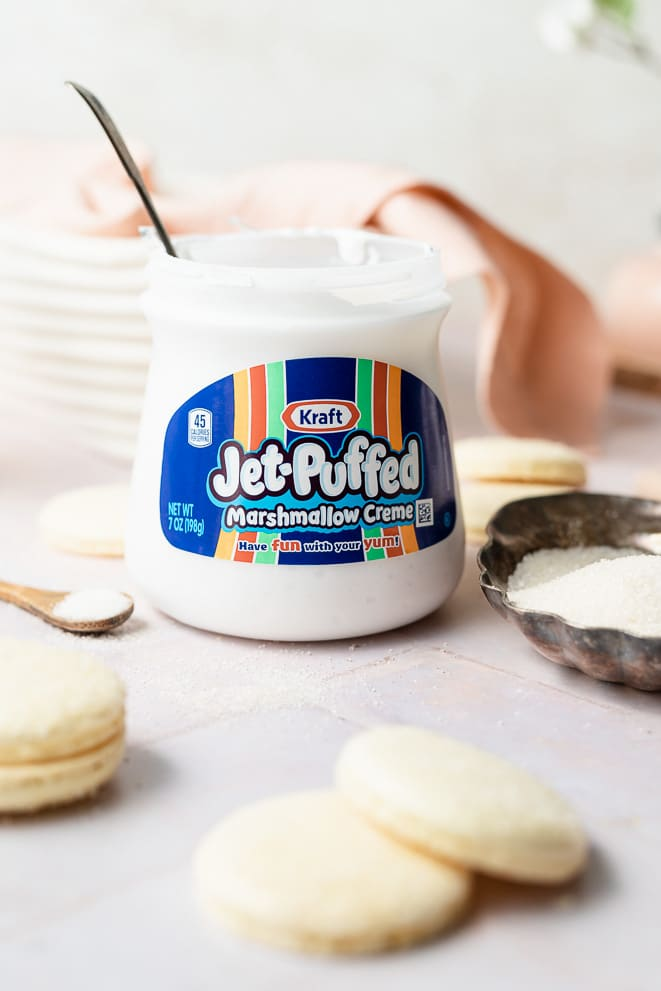 marshmallow fluff container with a spoon coming out of it