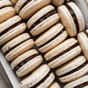 rows of macarons lined up in a baking tray