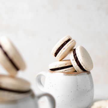 macarons stacked in a mug