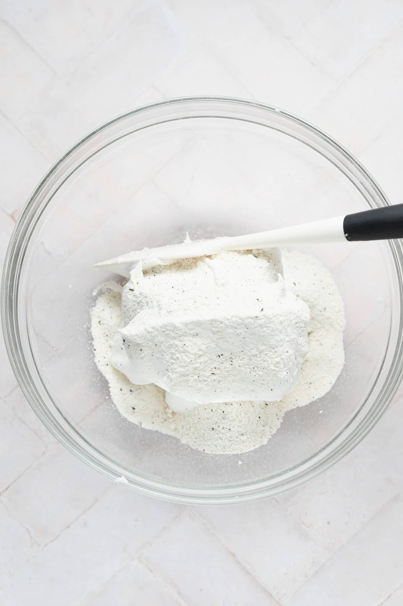 adding the dry ingredients to the meringue