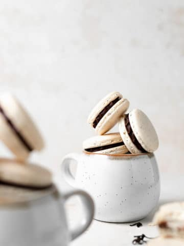 macarons in a mug stacked on top of each other