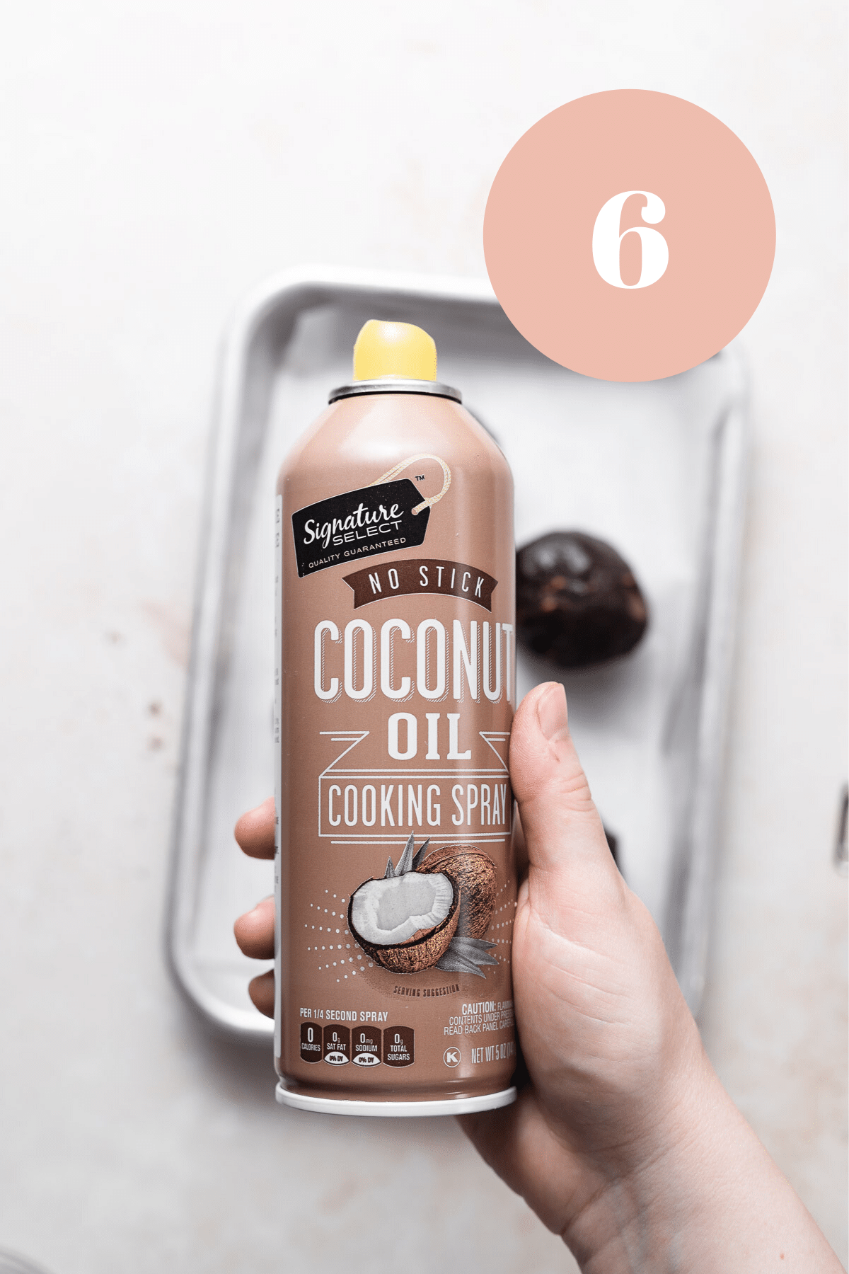 using a coconut oil baking spray to oil their hands