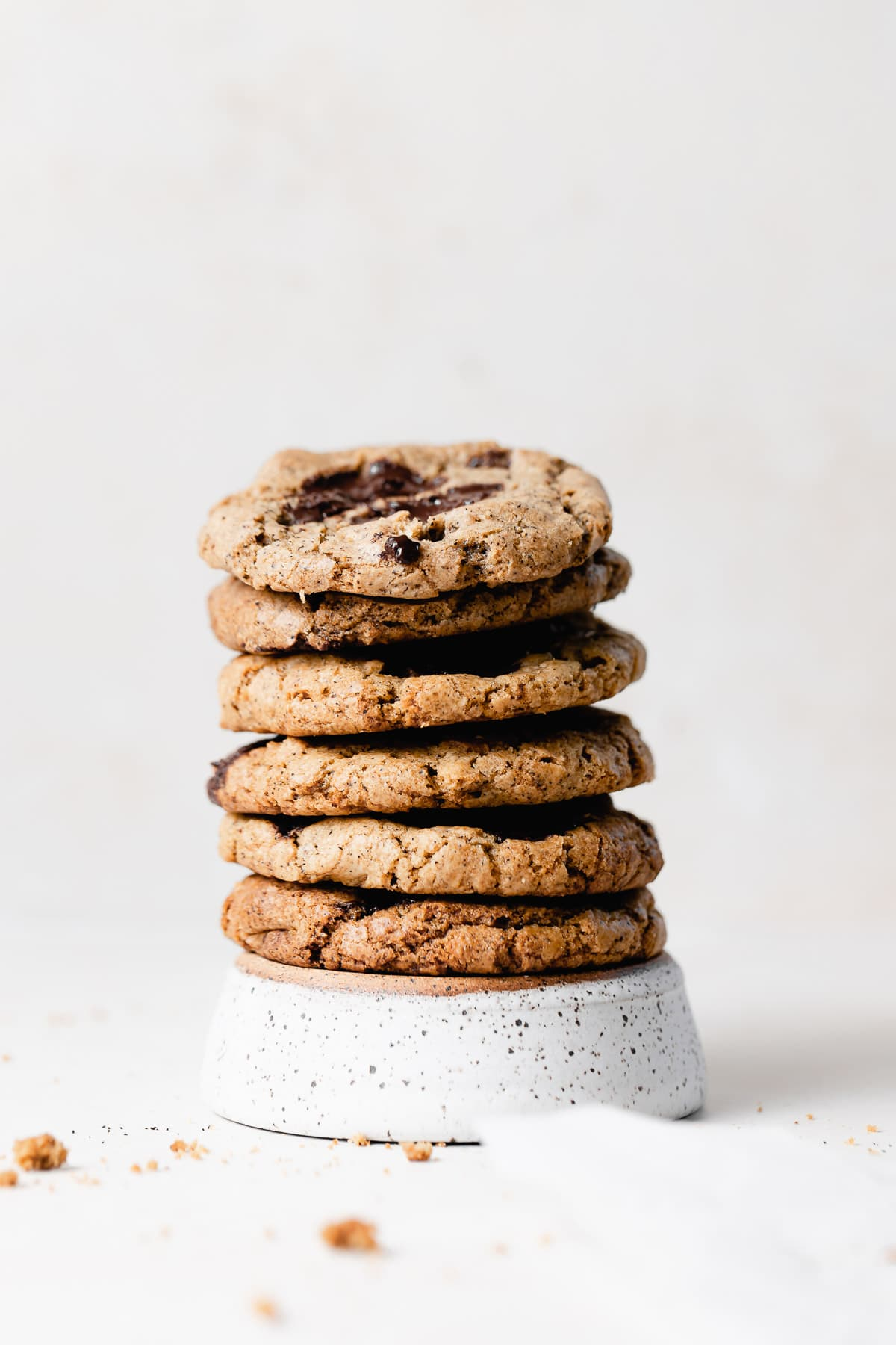 a stack of cookies on a white dish