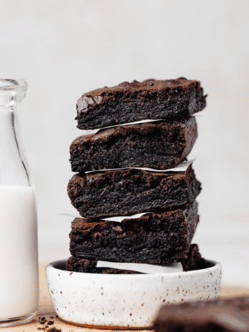 a stack of five brownies in a white dish