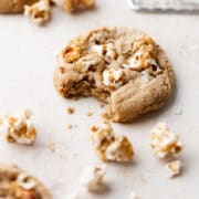 a cookie with a bite taken out of it on a white surface