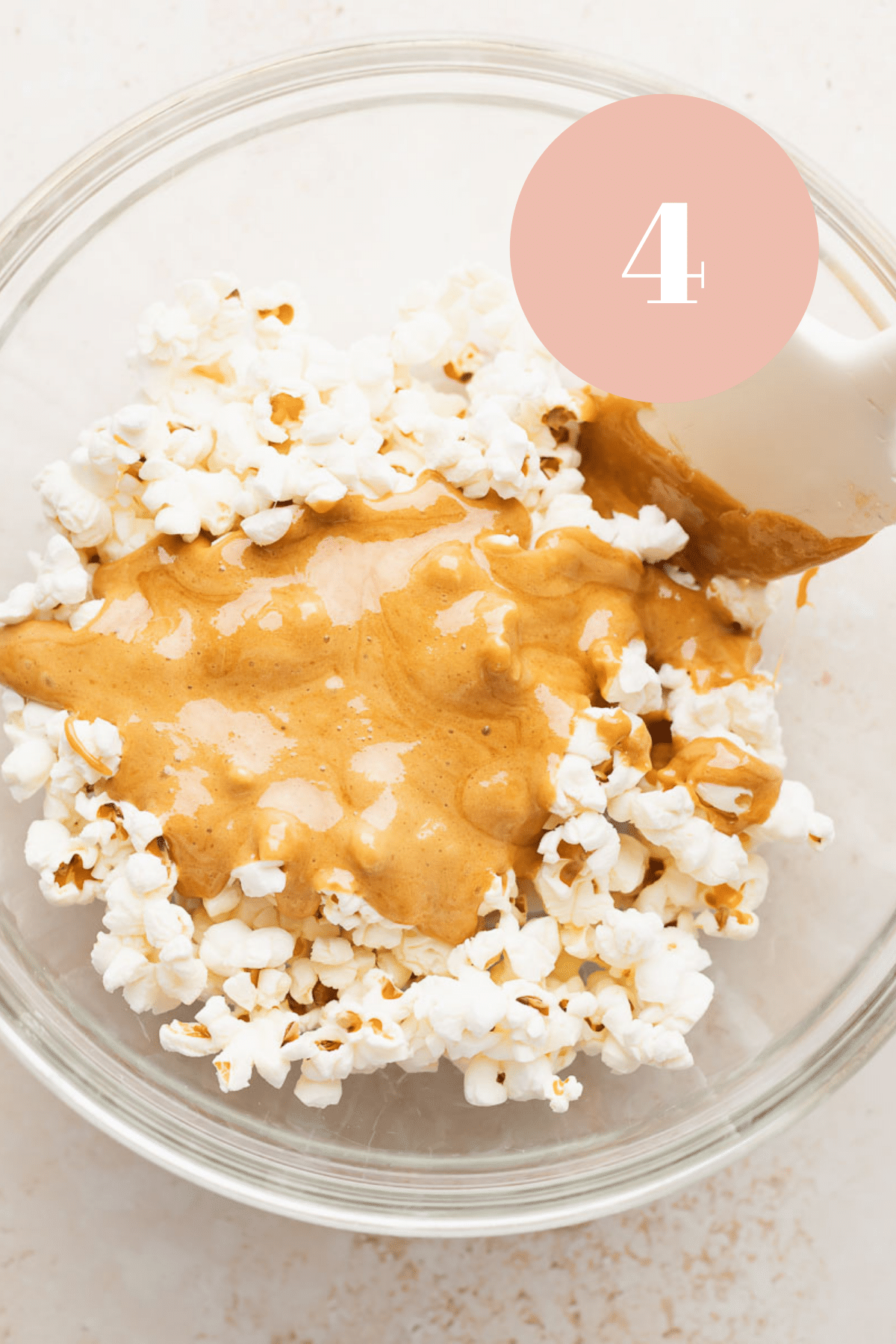 a bowl of the popcorn after the caramel is poured on top of it