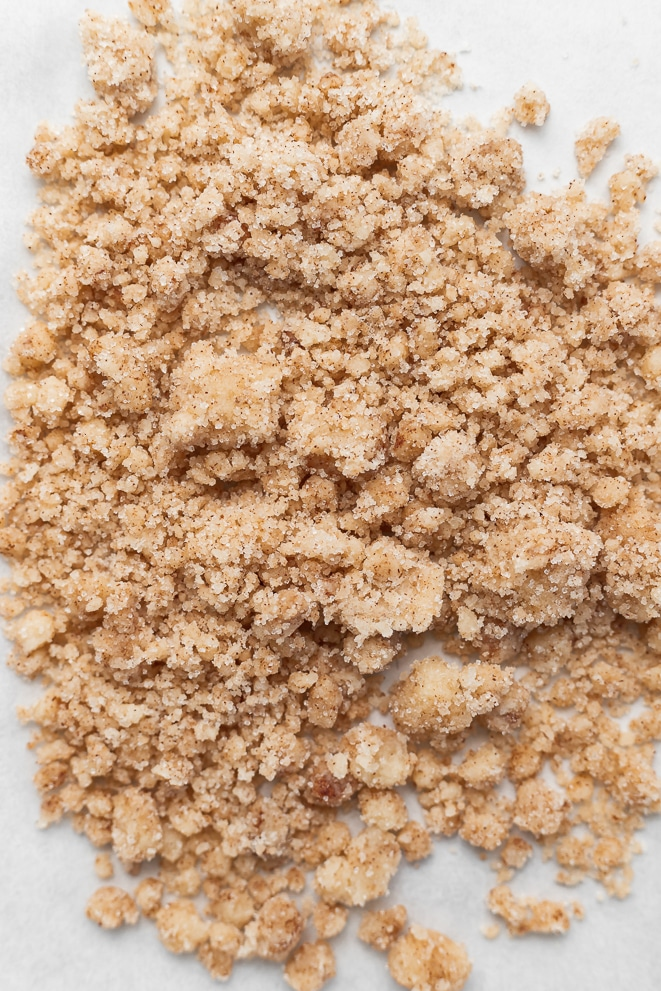brown sugar cinnamon crumb on a pan with parchment