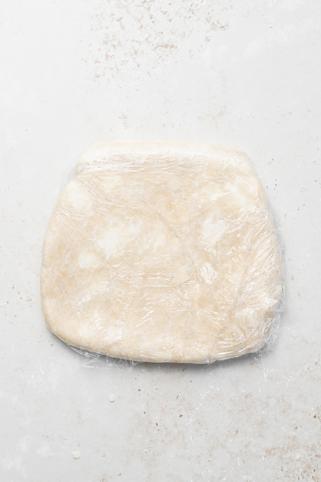 finished pie dough formed into a round disk