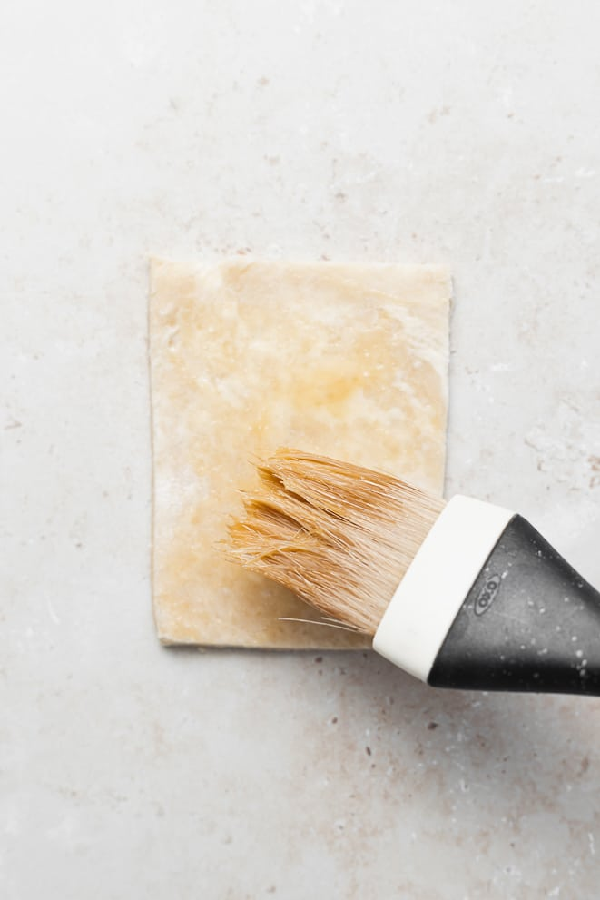 dough rectangle that is being brushed with a bit of egg