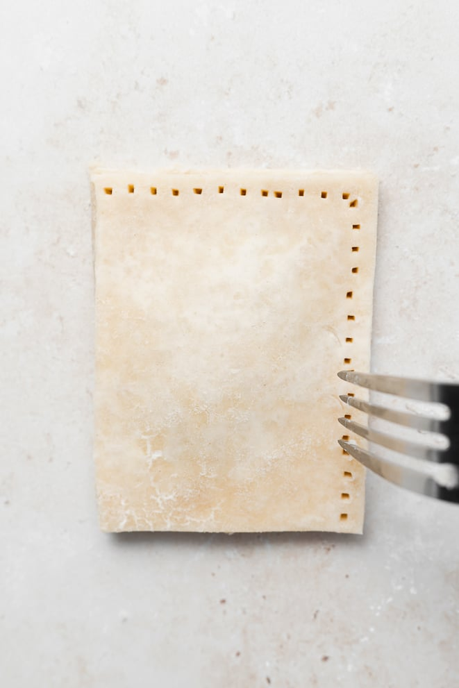 poking holes into the edge of the pop tart with a fork