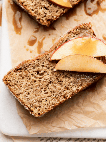 overhead shot of a slice of the loaf topped with fresh apple slices