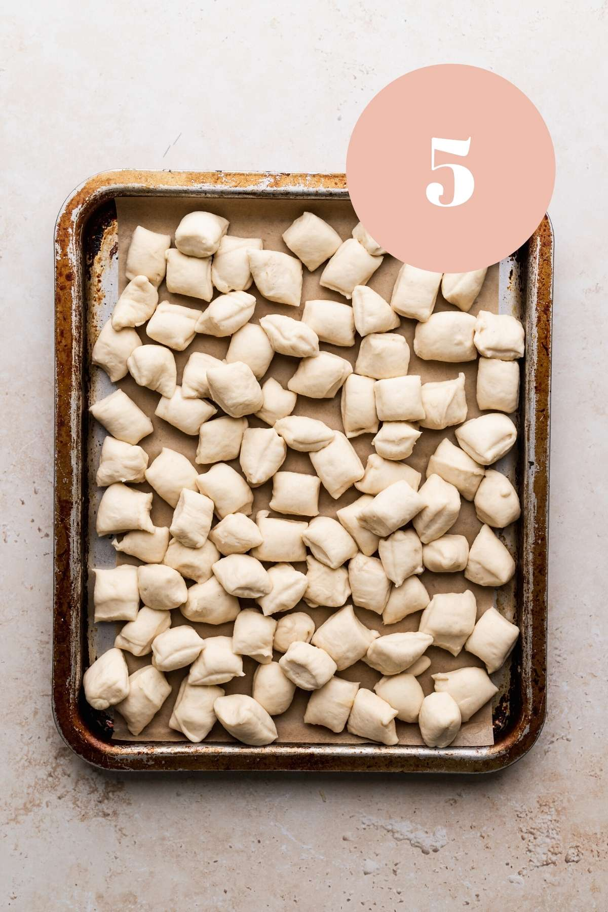 the parmesan bread bites on a pan.